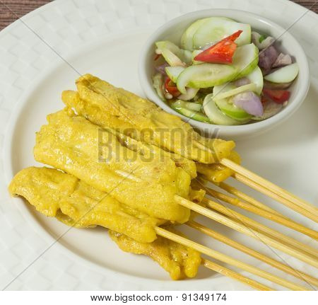 Delicious Grilled Pork Satay Served With Cucumber Salad