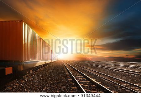 Industry Container Trains Running On Railways Track Against Beautiful Sun Set Sky Use For Land Trans