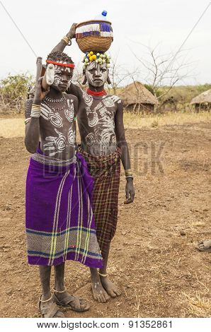 Boys From Mursi Tribe With Machine Gun In Mirobey Village. Omo Valley. Ethiopia.