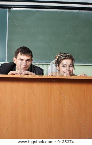 newlyweds in school