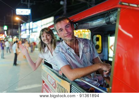 PHUKET, THAILAND - OCTOBER 20, 2011: tourists in tuk-tuk. Phuket have reputation as a partying hotspot with go-go bars, ladyboy cabaret shows, discos and clubs.
