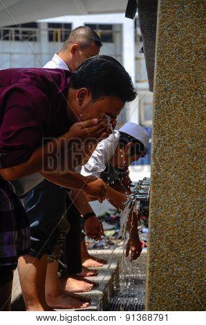 Men using the ablution of Cyberjaya Mosque in Cyberjaya, Malaysia