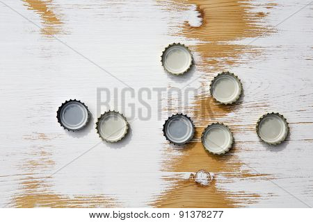 Bottle Cap On Rustic Wooden Background