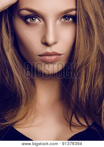 Potrait Of Beautiful Young Woman With Dark Hair And Green Eyes