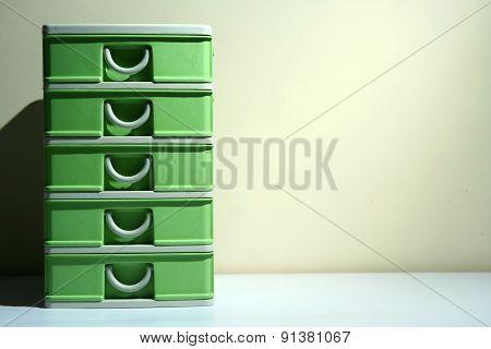 Green plastic organizer drawer
