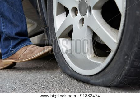 Motorist Kicking Flat Tyre On Car