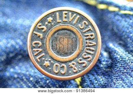 Closeup of Levi Strauss button on blue jeans