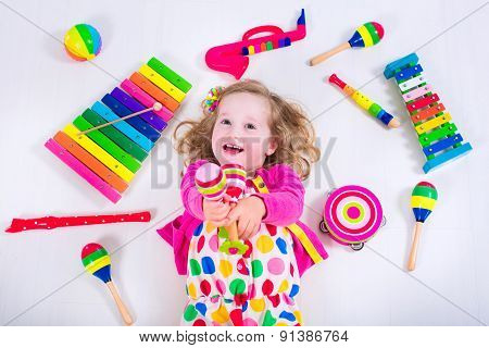Little Girl With Music Instruments