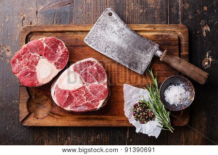 Raw Fresh Cross Cut Veal Shank And Seasonings For Making Osso Buco On Wooden Cutting Board With Meat