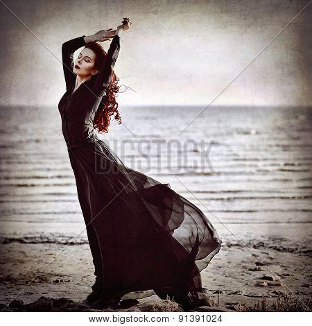 Beautiful Goth Girl Standing On Sea Coast. Grunge Texture Effect