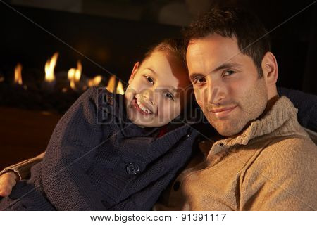 Portrait father and daughter by firelight