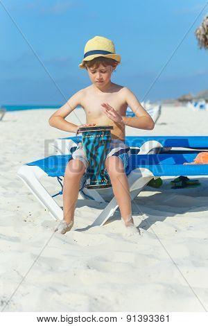 Boy playing on darbuka
