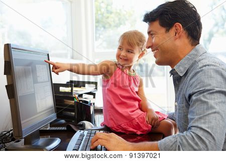 Father working in home office with daughter