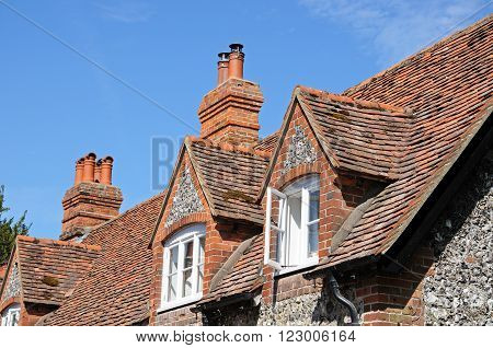 Pretty brick and flint cottages with dormer windows along a village street Hambledon Oxfordshire England UK Western Europe.