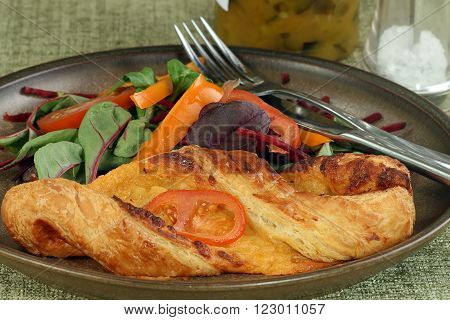 baked cheese pastry with mixed salad leaves
