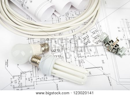 Architecture plan and rolls of blueprints with cabel and bulbs. Building concept