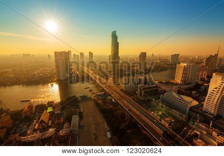 Chao Phraya river and high building sky scrapper in heart of bangkok thailand