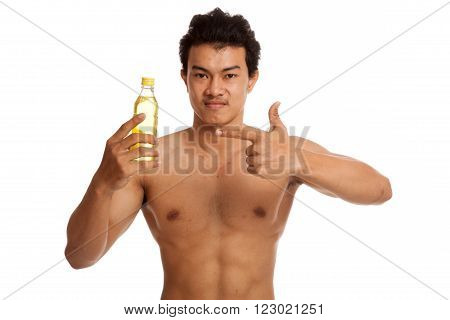 Muscular Asian man point to electrolyte drink  isolated on white background