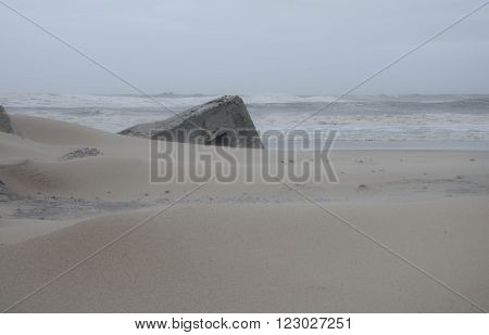 remains of a bunker on a beach in Denmark