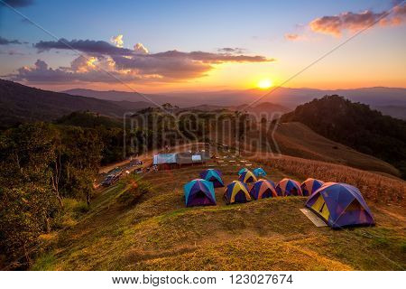 Activities tent on a hill in the countryside.