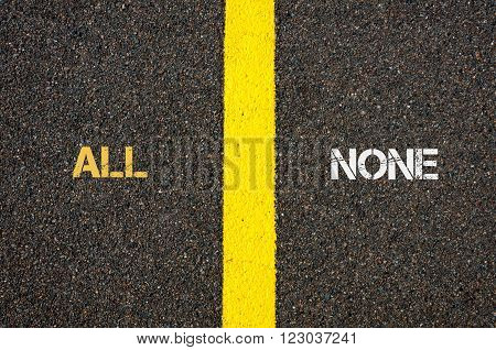 Antonym concept of ALL versus NONE written over tarmac road marking yellow paint separating line between words