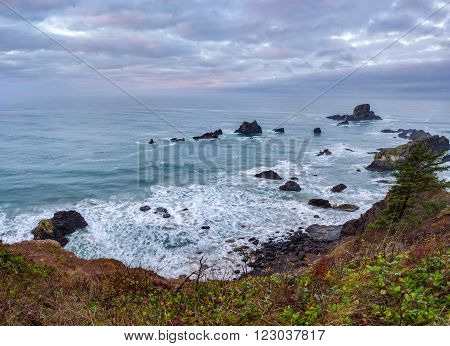 Sunrise at Pacific coast from Ecola State Park viewpoint, Oregon poster