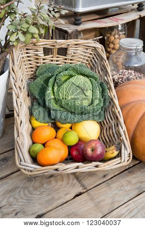 Apple cabbage coleslaw and fresh fruit on sale from greengrocers at market place