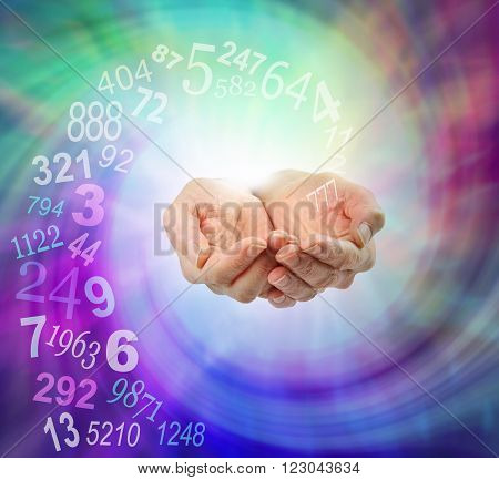 Ask a Numerologist for guidance - female cupped hands emerging from an ethereal multicolored spiraling energy field and a swirl of random numbers coming into her hands with copy space poster