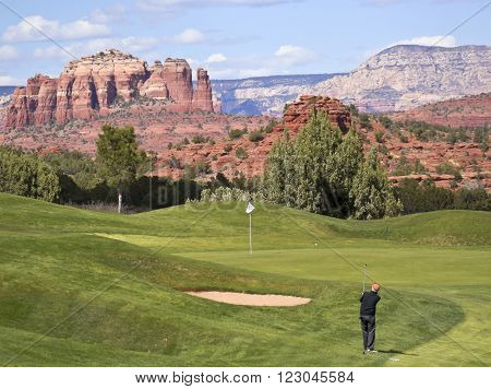 SEDONA, ARIZONA, MARCH 8. The Sedona Golf Resort on March 8, 2016, in Sedona, Arizona. A Golfer Takes a Chip Shot from the Rough in Sedona, Arizona.