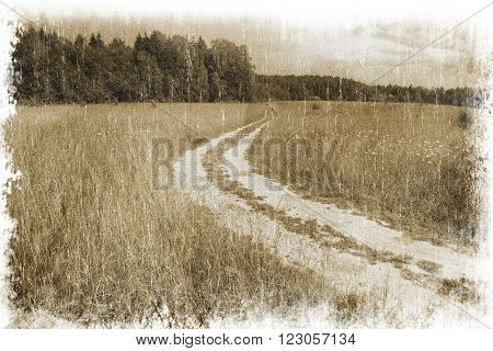 Rural landscape with a road across the field (vintage style)