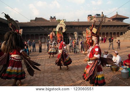Bhaktapur, Nepal -  April 19 2013: Several Unknown Lamas Perform A Ritual Dance In Celebration Of Ne