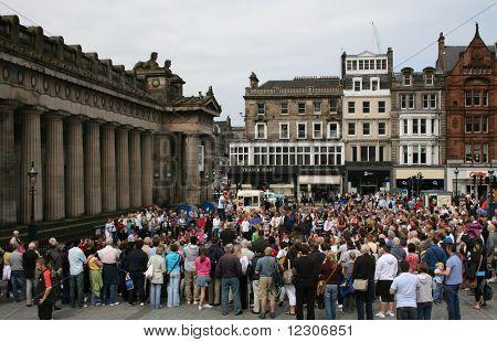 spectators watching performer juggling outside Scottish Art museum edinburgh