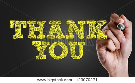 Hand writing the text: Thank You