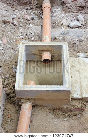 The construction of a new storm drain with two inlets being built