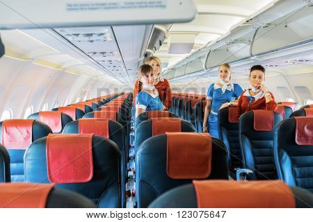 Ukraine, Borispol - MAY 22 : Flight attendants in the cabin on May 22, 2015 in Borispol, Ukraine