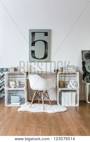 Original decorations in modern hipster study room with wooden parquet