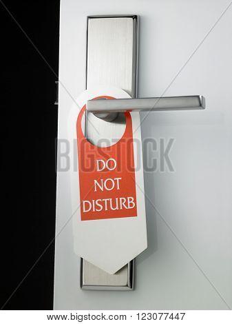 do not disturb door sign hanging at door handle poster