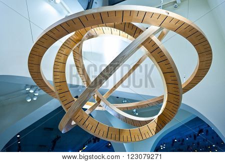 Dammam, Saudi Arabia - November 17, 2008: A suspended wooden  art work in the Aramco exibition centre.