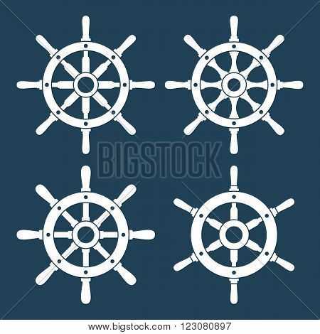 Ship's or boat's wheels vector icons set. Collection of 4 vector silhouettes of ship's or boat's steering wheels. EPS8 illustration.