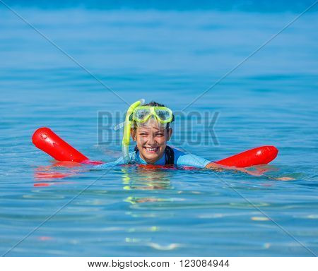 Joyful girl in mask reding scuba dive.