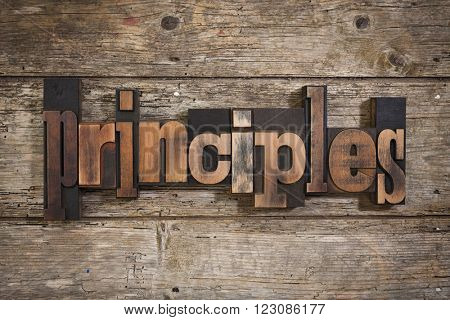 principles, single word set with vintage letterpress printing blocks on rustic wooden background