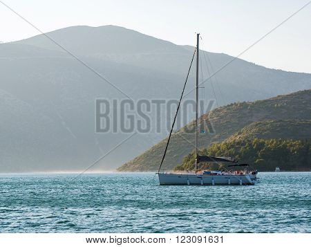sailing boats with tourists visiting the beautiful island of Ithaca July 27 2015 Greece