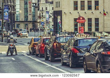 Bucharest, Romania - March 16, 2014: Rush hour, traffic jam on Victory Avenue (Calea Victoriei), a major avenue in central Bucharest city.
