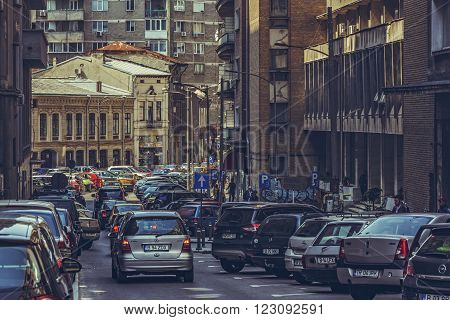 Bucharest, Romania - April 14, 2014: Rush hour, traffic jam, overcrowded street downtown Bucharest city, the capital and the largest and most prosperous city of Romania.