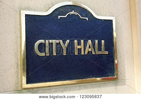 City Hall sign on the outise wall of a local government building close up