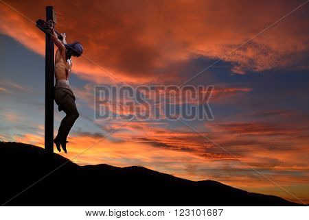 Jesus Christ on the cross over dramatic sky background