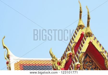 gold of gable apex architecture in thailand temple. In Thailand public domain or treasure of Buddhism. no copyright and no name of artist appear.