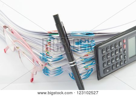 Pen And Step Pile Of Paperwork With Spectacles And Calculator