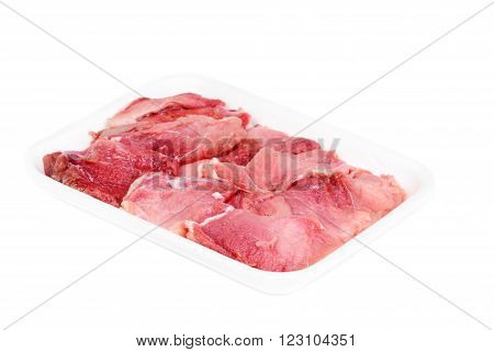 plastic pack of raw meat slices isolated on the white background