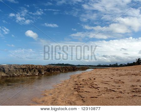 Barrier reef, blue sky, sand